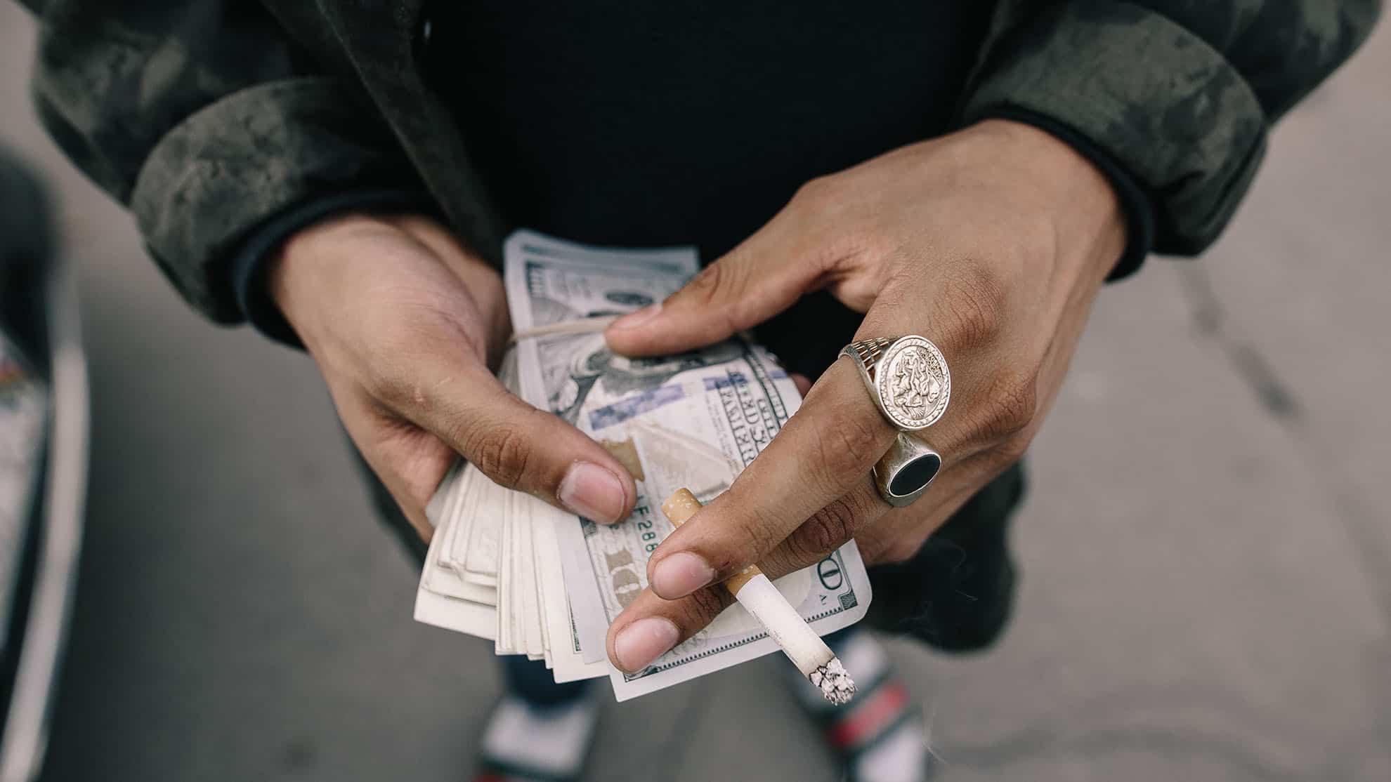 Man holding dollar banknotes